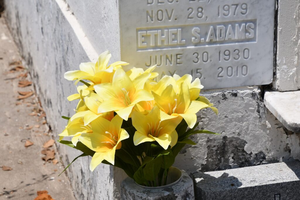 headstone with flowers