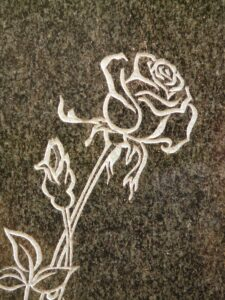 rose carving on granite affects Houston headstone cost